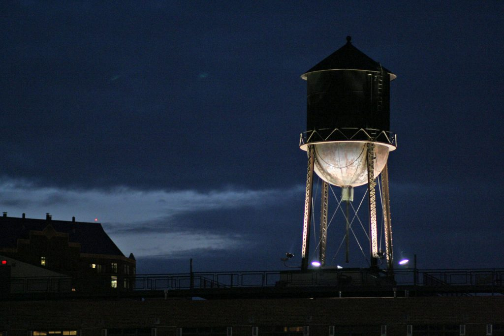 """Water tower - night"" by andylangager is licensed under CC BY-NC 2.0"