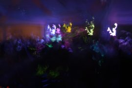 Dark party scene with blurry lights and people